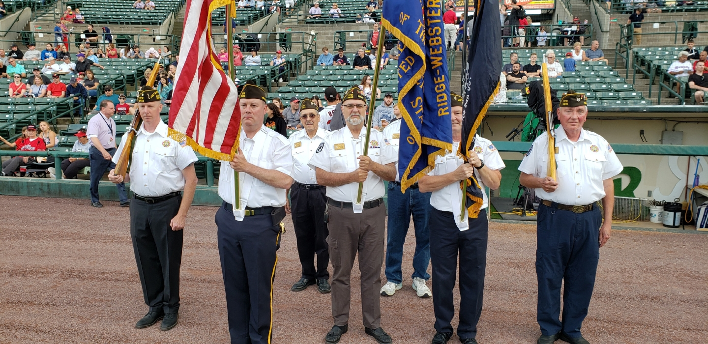 Members of VFW Post 9483 presenting Colors at a Rochester Redwings game.